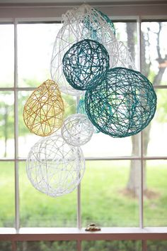 homemade photo chandelier - these are easy just use glue and water mixture with yarn.  Blow up balloons dip yarn in glue mixture and wrap around balloon.  Let dry then pop balloon.