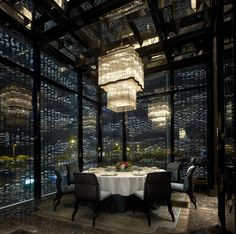 Intensely textured room conveyed by the glass panels that create the room and the ceiling pattern. The chandelier also adds to the overall texture of the room. Both very visual and dynamic. Important scale.