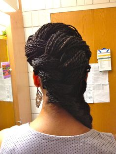 Senegalese Twists in a side braid (Katniss braid)....love this,  Go To www.likegossip.com to get more Gossip News!