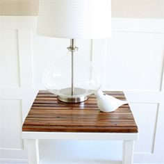 Learn how to turn an old table into a rustic and modern piece using spray paint and distressed wood.