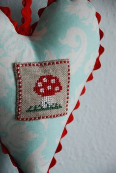 red and aqua heart with cross-stitch patch