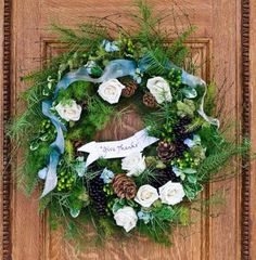 """A """"Give Thanks"""" wreath sets a welcoming tone at your front door. Details + more Thanksgiving decorating ideas: http://www.midwestliving.com/holidays/thanksgiving/easy-ideas-for-thanksgiving-decorating/?page=2,0"""