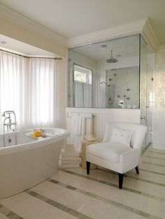 In LOVE with that striped floor tile, breadboard shower surround and thick moulding on top. White tile in shower with framed tile behind head to match stripes. Done and done.