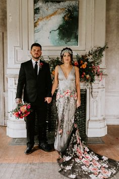Claire Pettibone colorful floral embroidered black tulle Raven wedding dress with open back and long train lined in sequins and ivory silk. | Pin discovered by Kelly's Closet bridal boutique in Atlanta, Georgia