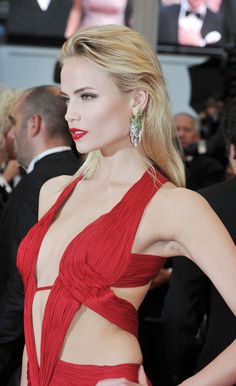 Natasha Poly wore Boucheron's Louise earrings in white and yellow gold set with diamonds and emeralds at Cannes Film Festival.
