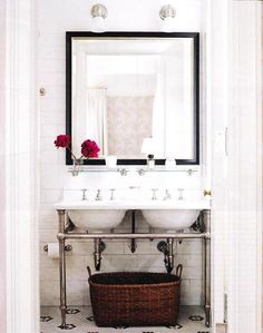 black and white bath.  double vanity + to the ceiling subway tile + mosaic flooring + pair of nickel sconces