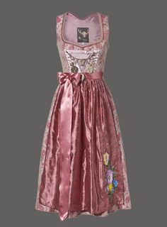 What a resplendently beautiful pink dirndl with a charivari across the bodice. #pink #dirndl #dress #German #folk #costume