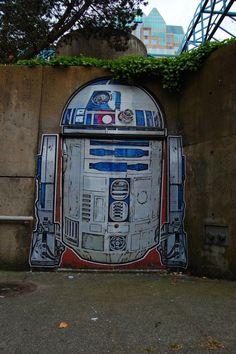 Graffiti Artist Turns Boring Doorway Into R2-D2
