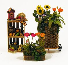 A colorful natural wicker cart with a fern, sunflowers, poppies and more $175  Wooden crate filled with wonderful things from the garden by Carol Farmer $49  Garden basket with orange and bright pink poppies $35