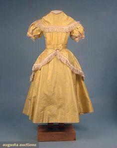 1860s Girl's silk taffeta lemon yellow dress, high waist, short puff sleeves, fringed over skirt, via Augusta Auctions.