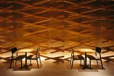 This Starbucks store near the Dazaifu Tenmangu shrine in Dazaifu, Japan features more than 2,000 wooden sticks that are woven into a lattice pattern. The goal is to make the store feel cave-like and fluid. lights, japan, shops, kengo kuma, light design, interiors, coffee, sticks, starbucks