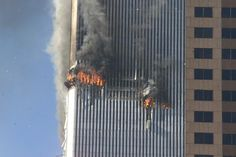 Debris falliing from one of the burning Twin Towers of the World Trade Center. September 11, 2001