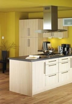 Sunny yellows on pinterest 27 pins for Butter cream colored kitchen cabinets