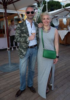 Army fatigue, grey maxi dress, green cross-body bag for pop of color | Gianluca Di Tondo from and Sandra Krstic from @DDB Worldwide  at the DDB party on Boulevard de la Croisette. #CannesLions