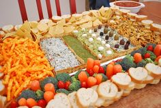 12 Awesome Edible Football Stadiums -- Carrots, broccoli and tomatoes give guests healthy options in this snackadium | tumblr.com super bowl, party dips, superbowl, football stadiums, food, football parties, gingerbread houses, snack, georgia bulldogs