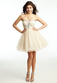 Arrive in style to your prom in an amazing party dress such as this Xscape design. Even though this is a short dress, it gives you all of the fabulous elements that will wow your friends at the prom! This strapless sweetheart dress is decorated with ab beading and shimmering accents for a stunning evening look. The full tulle skirt grabs onlooker's attention and doesn't let go with its bubbly charm and elegant volume. Combining such a fun skirt and gorgeous bodice this prom dress looks as thoug…