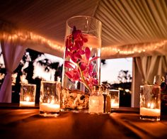 Submerged flowers surrounded by candles
