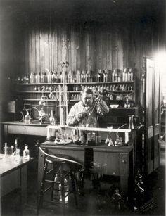 Edison in lab coat. Scene is his private lab in West Orange.