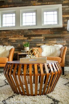 Souk Wool Rug + Bentwood Coffee Table + Stikwood Wall + Tulip Leather Chairs + Sculptural Sphere from west elm