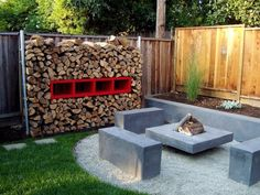 Nice fire wood wall flanking a concrete bench and firepit.