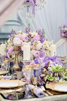 Lady Lilac Wedding Centerpiece from @WedLuxe