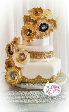 Glided gold round and hexagon ivory fondant custom made unique wedding cake with vintage design edible gold lace and elegant sugar flowers with rhinestone brooches