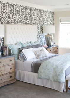 House of Turquoise: Charlotte Hale of Plum Pretty Sugar - white tufted upholstered platform bed and wood dressers used as nightstands