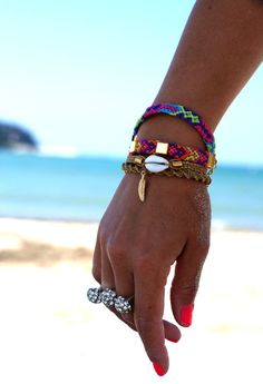 neon friendship bracelets and seashells
