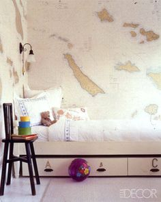 ELLE DECOR- map wall.  Maybe not an entire wall, but a framed nautical map would be great