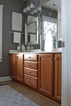 Grey bathroom with wood vanity