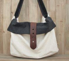 White-black Leather-canvas tote /Leather bag/Canvas bag /Shopping bag/ Stitch bag/Shoulder bag/iPad bag. $69,00, via Etsy.