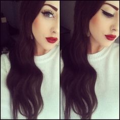 Classic winged liner + red lips.