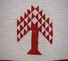 Perrrrrfect for country Christmas motif!  79 in x 61 in. Perfect for wall hanging or table topper or draped over chair near Christmas tree!!! Red/white tree of life w/red border on 4 sides, hand pieced, machine sewn quilt!!!