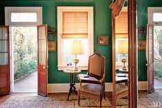 "Actress Helen Mirren and director Taylor Hackford filled their New Orleans bungalow with a bounty of local antiques and, in the master bedroom, set them against a bold hunter-green backdrop. ""Green walls create a cool, dark refuge from the unbearably hot summers,"" says Hackford"