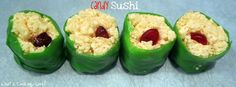 Put rice krispies around a folded gummy worm, then wrap in half of a green fruit roll up. Candy Sushi!