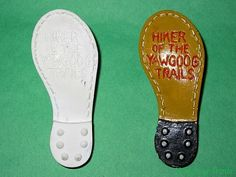 Plaster Hiker of the Yawgoog Trails neckerchief slides, unpainted and painted. The slides were discontinued in the 1980s, but the #Yawgoog patch segment continues.  Image by David R. Brierley.