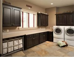 Another idea for laundry in basement storage area.  I love the multi-unit laundry cart, ample counter space, and tons of cabinet storage! Transitional Cabinet from Mullet Cabinet