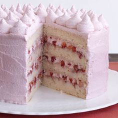 Alternative layers of meringue buttercream with luscious #strawberries and sweet icing for the perfect #valentine #dessert. #womansday