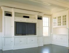 built in entertainment center  -- closed with speakers on top. Slide-in doors with components inside?