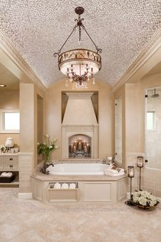 Master Bathroom - tub with storage, fireplace, beautiful lighting fixture