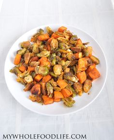 Smokey Roasted Brussel Sprouts and Sweet Potatoes.  Serve these over quinoa or rice for a complete meal.  Healthy and easy!  You will want to eat the whole tray!  #vegan #glutenfree #paleo #healthyrecipe