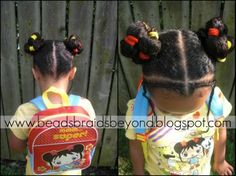 cornrows in front, two banded ponytails into buns on the side. I saw the video how-to of this. I'll try to post that too...