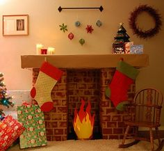 OH MY!!!!! We are SO making one of these this year!! How fun for the kids!! They made a faux fireplace out of cardboard boxes and stamped butcher paper!