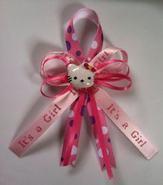 Hello Kitty baby shower pins on Etsy, $15.00