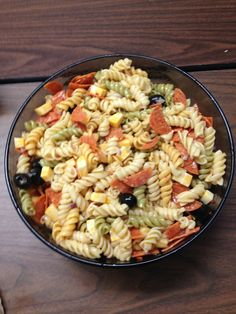 Easy Pasta Salad   1 pk of cooked spiral pasta 1 pk of Colby Jack cube cheese 1 pk Pepperoni 1 can of medium pitted black olives 1/3 cup of finely chopped red onion Italian dressing Tony's Seasoning   Let pasta cool, then mix all ingredients in a large bowl and serve.