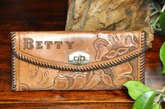 Vintage hand Carved Tooled Leather Wallet by StardustBijoux, $25.00 I want one, with my name!!:)
