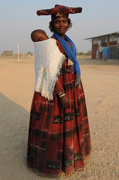 Africa   Portrait of an Herero woman carrying her child, Namibia, southern Africa