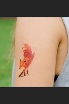 Watercolor tattoo, I really want one like this they are so cool