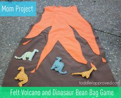 Toddler Approved!: Mom Project: Felt Volcano and Dinosaur Bean Bag Game  Someone soon has to love dinos right?  I mean besides me?