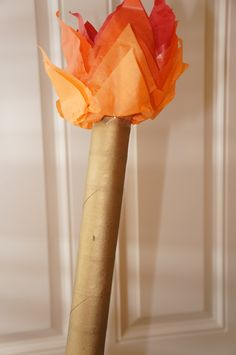 Olympic Torch. Spray paint a paper towel tube gold and add tissue paper for the flame.